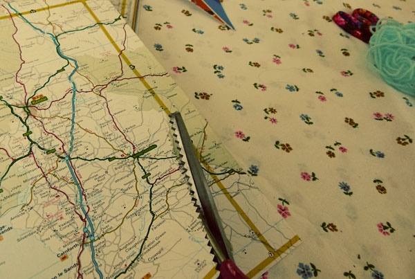 Cutting out map bunting DIY Sunday: Map Bunting