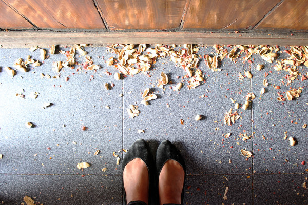 Peanut shells on floor at Taberna do Poncha