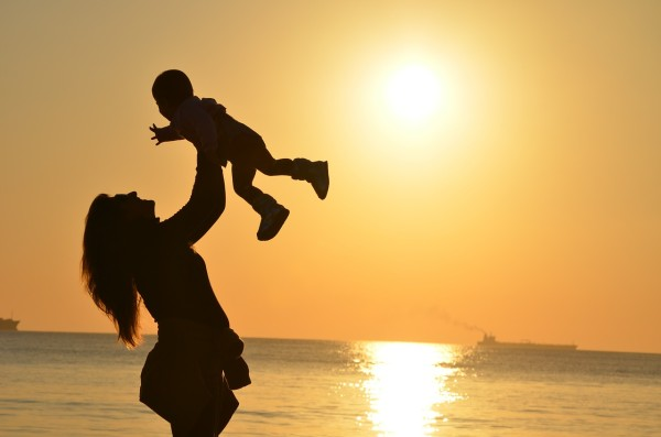 Mum and child on beach