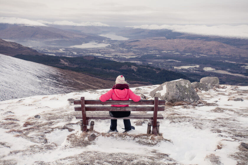 Travel blogger Kathi Kamleitner taking in the view of Fort William and the Highlands from the Nevis Range in Scotland.