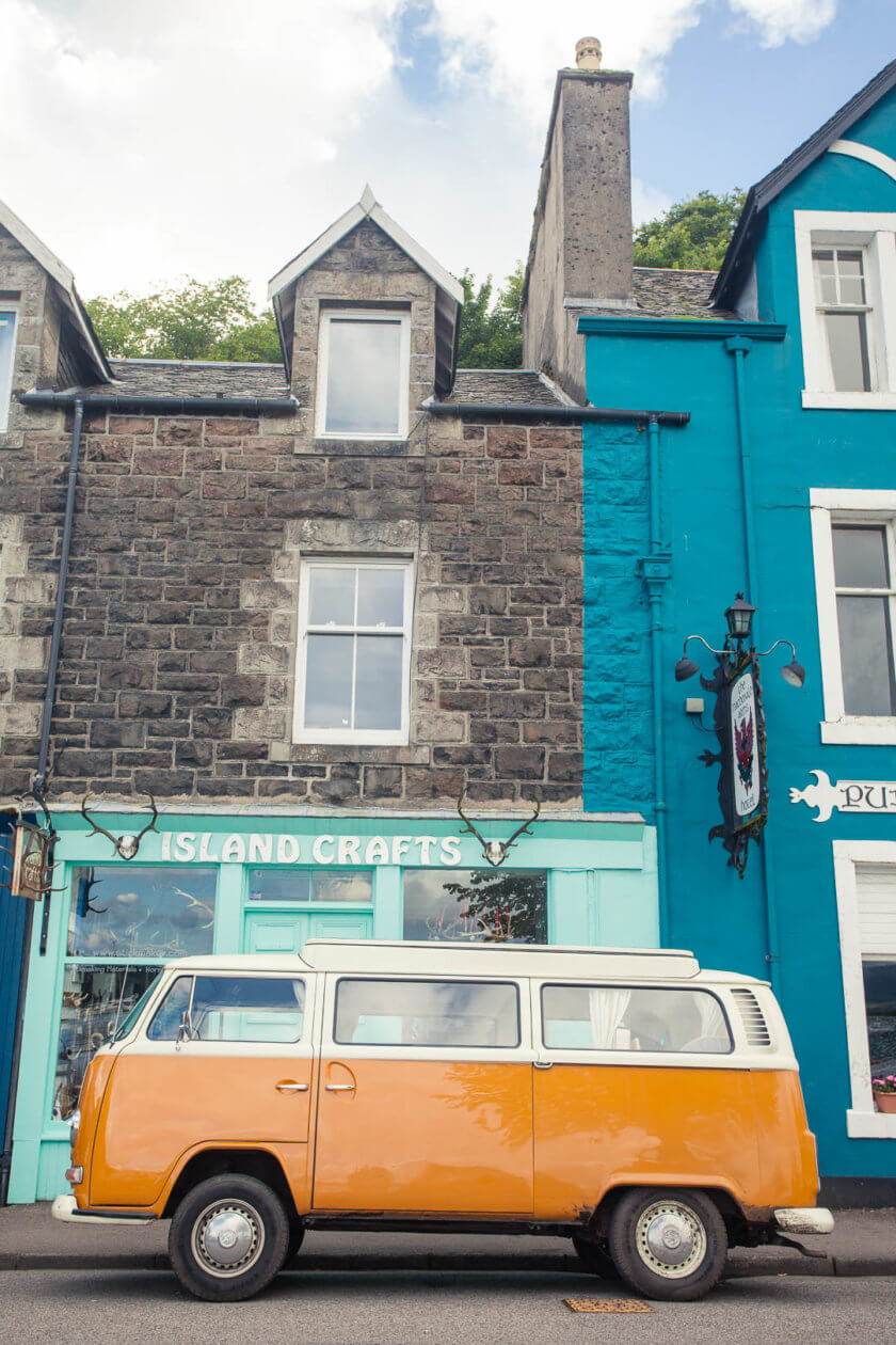 An orange campervan in Tobermory on the Isle of Mull in Scotland.