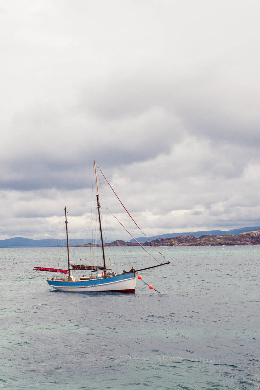 A boat anchoring in the harbour of Iona in Scotland.