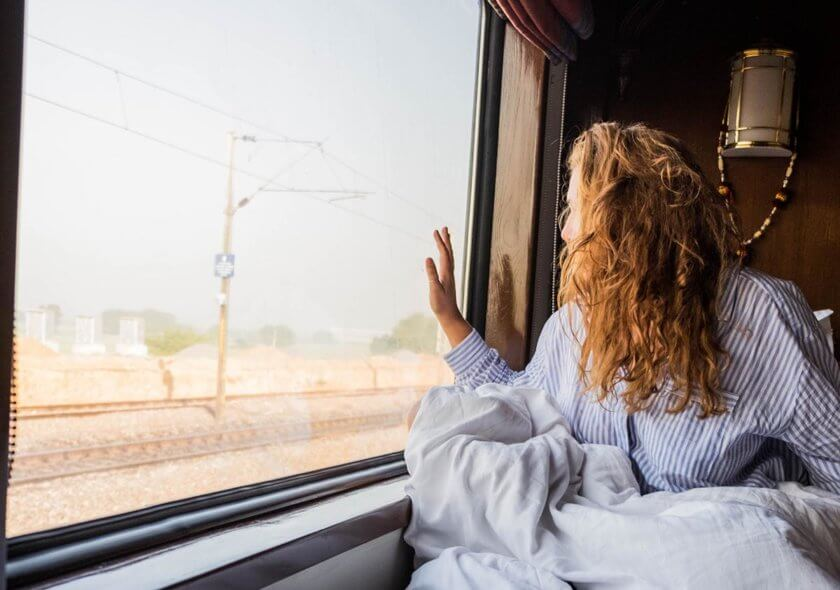 Woman looking out of a train window in India