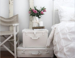 Old suitcases as charming storage space