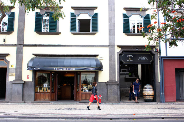 Woman walking past Blandys Wine in Funchal
