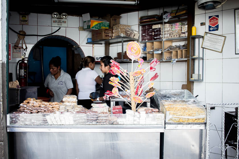 The Travelettes Guide to Quito - Old Town Selling Sweets 2