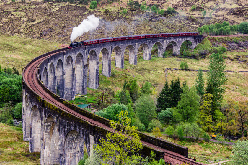 The Jacobite Steam Train in Scotland, crossing the Glenfinnan Viaduct like in the Harry Potter films.