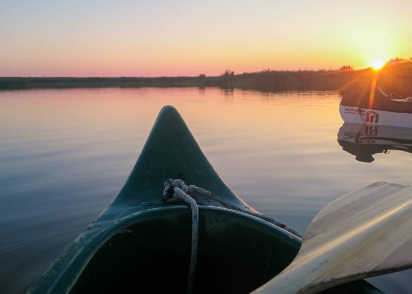 A sunrise canoe trip on Lake Neusiedl in Austria.