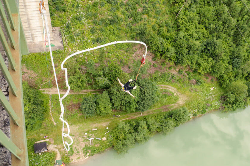 Girl bungee jumping from Jauntal bridge in Austria