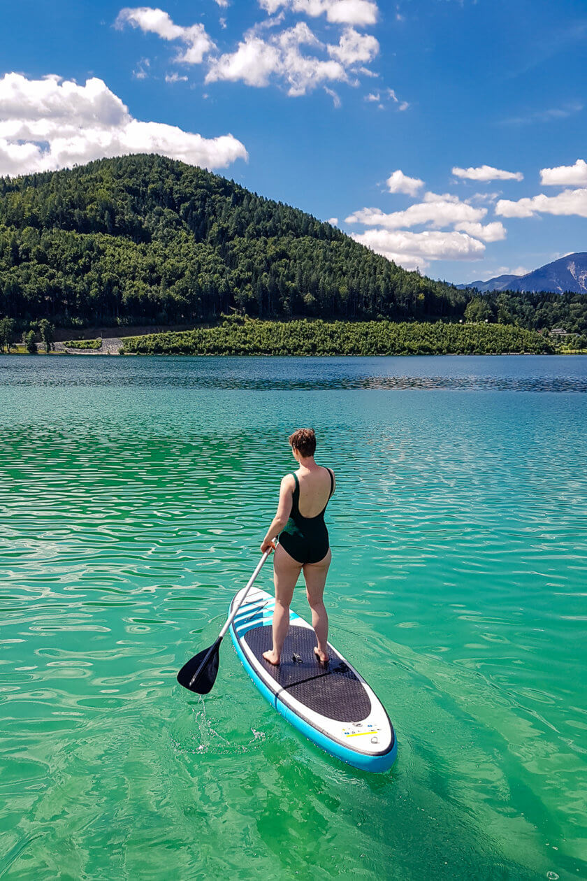 Girl stand up paddling on a lake in Austria
