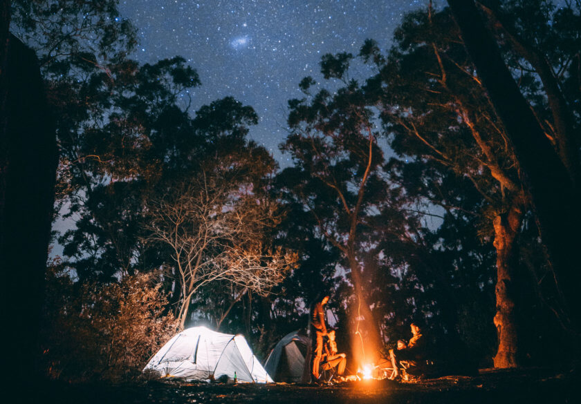tent at night with campfire and stars