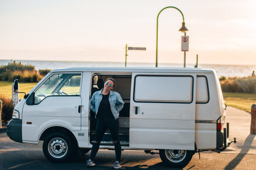 girl standing in front of ford econovan in australia